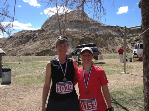 Paige (right) all smiles after winning her age category at the Pump It Up Run in Dinosaur Provincial Park